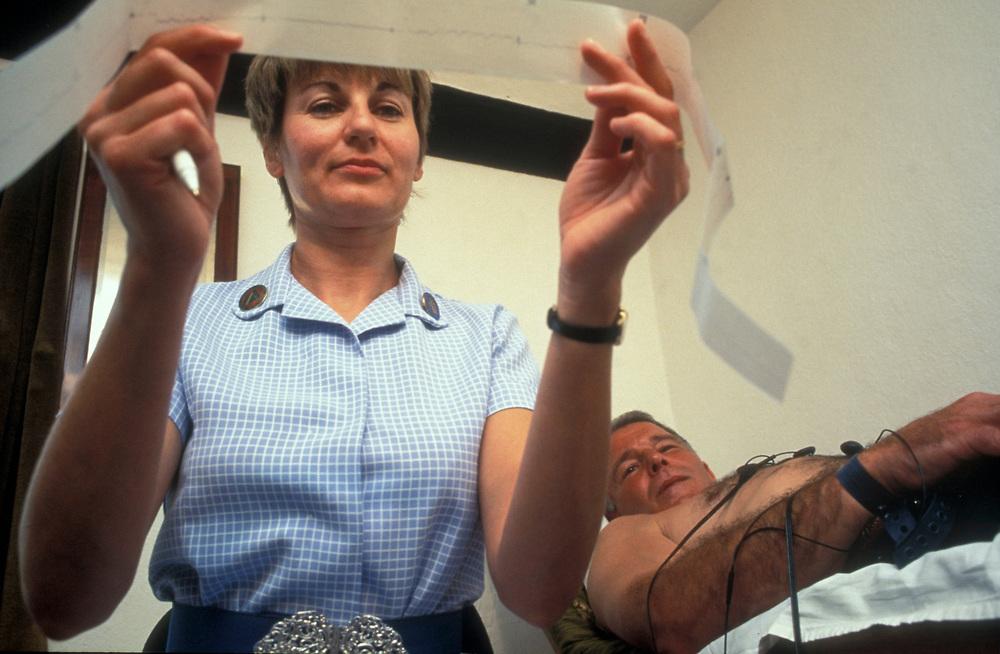 Nurse checking cardiogram UK