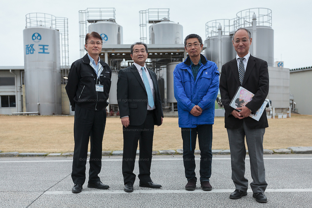 Nobuhiro Suzuki, (second from left) the CEO of Rakuou Milk products factory with other staff in Koriyama, Fukushima, Japan Sunday November 22nd 2015