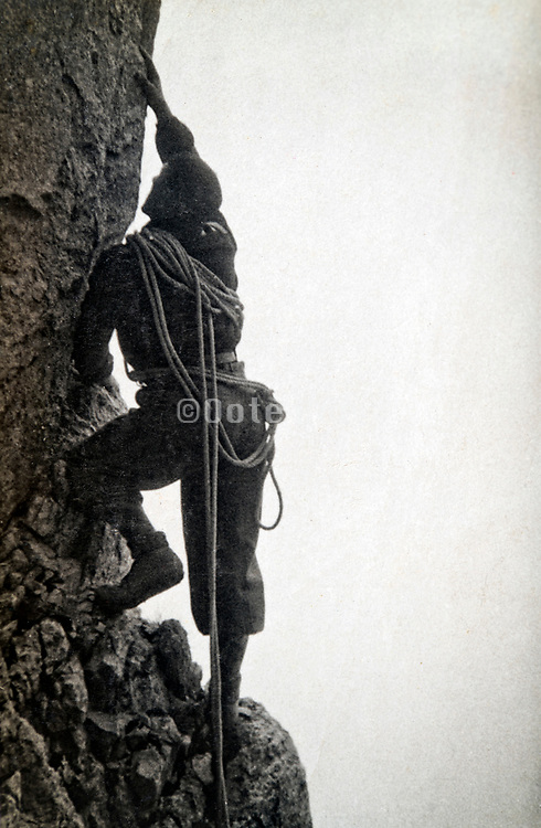 rock climber scaling a rock wall 1933 France Alps