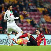 Galatasaray's Selcuk Inan (R) during their Turkish Super League soccer match Galatasaray between Bursaspor at the AliSamiYen Spor Kompleksi TT Arena at Seyrantepe in Istanbul Turkey on friday, 04 December 2015. Photo by Kurtulus YILMAZ/TURKPIX