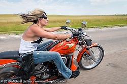 Jodie Weiss riding her Harley-Davidson Softail back to Sturgis on the annual Michael Lichter - Sugar Bear Ride hosted by Jay Allen from the Easyriders Saloon during the Sturgis Black Hills Motorcycle Rally. SD, USA. Sunday, August 3, 2014. Photography ©2014 Michael Lichter.