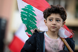 ©2020 Tom Nicholson. 14/01/2020. Beirut, Lebanon. A young boy looks at the anti-government demonstrators, as they block roads in central Beirut. Various national demonstrations took place today as part of a wider movement which started in mid October 2019, campaigning against government corruption and economic crisis. Photo credit : Tom Nicholson