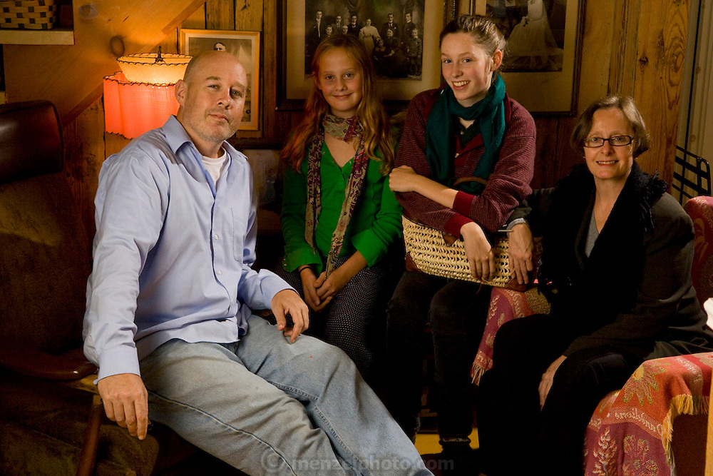 Finken family at home in their straw bale suburban home in Gatineau, Quebec, Canada. The Finken family: Kirk, Danielle Roy, Anna, and Coco Simone (called Coco). The image is part of a collection of images and documentation for Hungry Planet 2, a continuation of work done after publication of the book project Hungry Planet: What the World Eats, by Peter Menzel & Faith D'Aluisio.