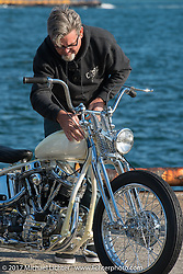 """Cycle Zombies's Big Scott Stopnik with his """"Full Moon"""" custom 1953 Harley-Davidson Panhead at the docks where it was picked up with all of the invited builder's bikes for the Mooneyes show. Yokohama, Japan. Saturday December 2, 2017. Photography ©2017 Michael Lichter."""