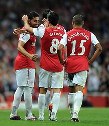 28.09.2011, Emirates Stadium, London, ENG, UEFA CL, Gruppe F, FC Arsenal (ENG) vs Olympiakos Piräus (GRE), im Bild Arsenal's Andre Santos is congratulated by team-mate Mikel Arteta after scoring his side's second goal // during the UEFA Champions League game, group F, ENG, UEFA CL, FC Arsenal (ENG) vs Olympiakos Piräus (GRE) at Emirates Stadium in London, United Kingdom on 2011/09/28. EXPA Pictures © 2011, PhotoCredit: EXPA/ Propaganda Photo/ Chris Brunskill +++++ ATTENTION - OUT OF ENGLAND/GBR+++++