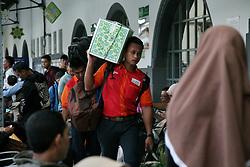 June 14, 2018 - Jakarta, DKI Jakarta, Indonesia - The porters work carrying luggage rail passengers. (Credit Image: © Kuncoro Widyo Rumpoko/Pacific Press via ZUMA Wire)