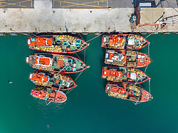 April 20, 2018 - Hout Bay, Western Cape, South Africa - Aerial view of eight fishing boats in Hout Bay, Cape Town. (Credit Image: © Amazing Aerial via ZUMA Wire)