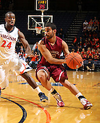 Nov 6, 2010; Charlottesville, VA, USA; Roanoke College g Melvin Felix (12) handles the ball in front of Virginia Cavaliers g KT Harrell (24) Saturday afternoon in exhibition action at John Paul Jones Arena. The Virginia men's basketball team recorded an 82-50 victory over Roanoke College.