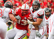 Ndamukong Suh is double teamed by Arkansas State at Memorial Stadium on Sept. 12, 2009. ©Aaron Babcock