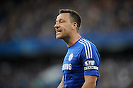 John Terry, the Chelsea captain looks on.  Barclays Premier league match, Chelsea v Manchester Utd at Stamford Bridge Stadium in London on Saturday 18th April 2015.<br /> pic by John Patrick Fletcher, Andrew Orchard sports photography.