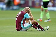 Gokhan Tore of West Ham United reacts after missing a chance to score. Premier league match, West Ham Utd v AFC Bournemouth at the London Stadium, Queen Elizabeth Olympic Park in London on Sunday 21st August 2016.<br /> pic by John Patrick Fletcher, Andrew Orchard sports photography.