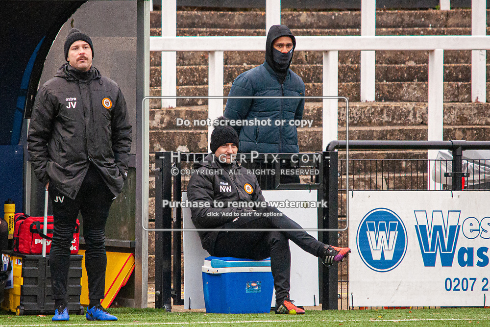 BROMLEY, UK - NOVEMBER 02: Joe Vines, Assistant Manager of Cray Wanderers FC, Nathan White, 1st Team Coach of Cray Wanderers FC, on the touchline with Mitchell Nelson, of Cray Wanderers FC, behind watching the BetVictor Isthmian Premier League match between Cray Wanderers and Worthing at Hayes Lane on November 2, 2019 in Bromley, UK. <br /> (Photo: Jon Hilliger)