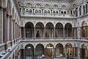 The architecture of the covered Durbar Court, inside the Foreign and Commonwealth Office (FCO) and part of the former India Office, on 17th September 2017, in Whitehall, London, England. Richard Colley Wellesley, 1st Marquess Wellesley KG PC PC (Ire) (1760-1842) was styled Viscount Wesley from birth until 1781 and was known as Earl of Mornington from 1781 until 1799. He was an Irish and British politician and colonial administrator.The main Foreign Office building is in King Charles Street, and was built by George Gilbert Scott in partnership with Matthew Digby Wyatt and completed in 1868 as part of the new block of government offices which included the India Office and later (1875) the Colonial and Home Offices. George Gilbert Scott was responsible for the overall classical design of these offices but he had an amicable partnership with Wyatt, the India Office's Surveyor, who designed and built the interior of the India Office.