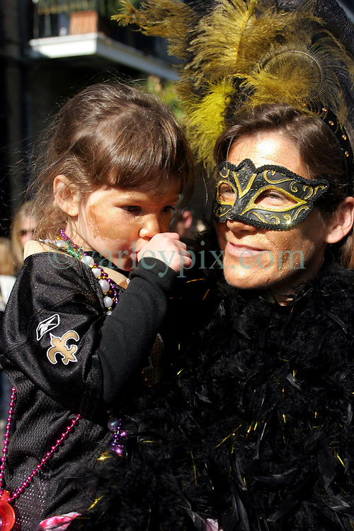 07 February 2010. New Orleans, Louisiana, USA. <br /> Super Bowl XL1V. <br /> Cecile Usdin (3yrs) and her mother Sarah Usdin. New Orleans Saints fans gather in the French Quarter in anticipation of the big game in Miami later in the day as the home team goes head to head with the Indianapolis Colts for Super Bowl 44. <br /> Photo ©; Charlie Varley/varleypix.com
