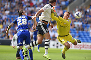 Cardiff city goalkeeper Simon Moore saves from Matt Smith of Fulham (c). Skybet football league championship match, Cardiff city v Fulham at the Cardiff city stadium in Cardiff, South Wales on Saturday 8th August  2015.<br /> pic by Andrew Orchard, Andrew Orchard sports photography.