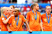 LYON, FRANCE - JULY 07: Shanice van de Sanden #7 of the Netherlands, second from left, stands dejected with teammates following the 2019 FIFA Women's World Cup France Final match between The United States of America and The Netherlands at Stade de Lyon on July 07, 2019 in Lyon, France. (Photo by Maddie Meyer - FIFA/FIFA via Getty Images)