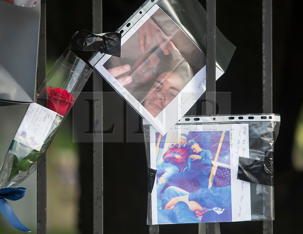 © Licensed to London News Pictures. 28/01/2018. London, UK. Flowers and tributes left at the scene where three teenage pedestrians were killed near a bus stop in Hayes, West London after a black Audi collided with them. Named locally as Harry Rice, Josh Kennedy and George Wilkinson, the three teenagers were hit on Friday night  close to the M4 Junction 4. A 28-year-old man has been arrested and a police are currently looking for a  second man believed to have been in the Audi.. Photo credit: Ben Cawthra/LNP