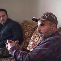 Abdulhamid Adi, right, talks about his life and transition from Syrian to Albuquerque during an interview in Gallup Monday.