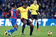 Christian Kabasele of Watford (R) holds off Wilfried Zaha of Crystal Palace (L). Premier League match, Crystal Palace v Watford at Selhurst Park in London on Tuesday 12th December 2017. pic by Steffan Bowen, Andrew Orchard sports photography.