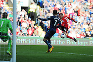 Cardiff city's Craig Bellamy has a shot at goal blocked by Newcastle's Davide Santon. Barclays Premier League match, Cardiff city v Newcastle Utd  at the Cardiff city stadium in Cardiff, South Wales on Saturday 5th Oct 2013. pic by Andrew Orchard, Andrew Orchard sports photography,