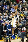 Golden State Warriors guard Patrick McCaw (0) shoots a jumper against the Atlanta Hawks at Oracle Arena in Oakland, Calif., on November 28, 2016. (Stan Olszewski/Special to S.F. Examiner)