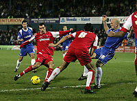 Photo: Paul Thomas.<br />Oldham Athletic v Swindon Town. Coca Cola League 1.<br />10/12/2005.<br />Neale McDermott (2nd, L) scores finally after a cleared penalty for Swindon.