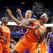 UNCASVILLE, CONNECTICUT- JULY 15: Chiney Ogwumike #13 of the Connecticut Sun rebounds while challenged by Candace Parker #3 of the Los Angeles Sparks during the Los Angeles Sparks Vs Connecticut Sun, WNBA regular season game at Mohegan Sun Arena on July 15, 2016 in Uncasville, Connecticut. (Photo by Tim Clayton/Corbis via Getty Images)