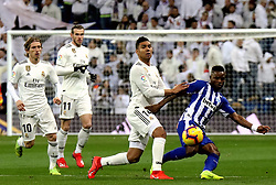 MADRID, Feb. 4, 2019  Real Madrid's Casemiro (2nd R) competes with Alaves' Wakaso Mubarak (1st R) during a Spanish La Liga match between Real Madrid and Alaves in Madrid, Spain, on Feb. 3, 2019. Real Madrid won 3-0. (Credit Image: © Edward F. Peters/Xinhua via ZUMA Wire)