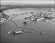 "Ackroyd 14801-1. ""Port of Portland. Aerial of dredge off Swan Island dry dock. August 25, 1967"" (dredging material from Willamette River at Swan Island dry dock being deposited in Mock's Bottom & Swan Island Industrial Park)"