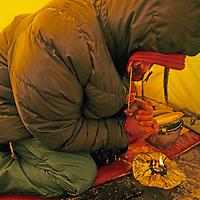 MOUNTAINEERING, SPITSBERGEN, Norway. Jay Jensen (MR) rewarms from sub-zero polar cold on ski expedition at 80 degrees north latitude.