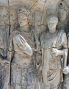 Trajan recruits soldiers. Arch of Trajan at Beneventum, AD 114.  /A cuirassed military god in the centre presents a recruit to the emperor.  The new soldier stands, feet together: his height is being measured by a wooden frame held by the soldier on the right.
