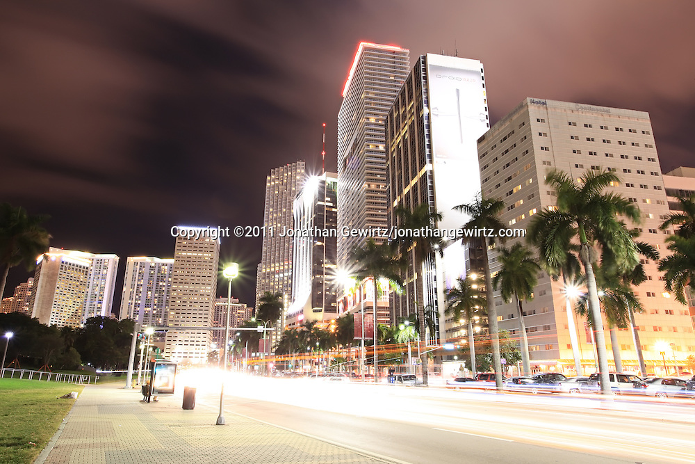 Condo, office and hotel buildings and traffic on Miami's Biscayne Boulevard at night (print version with logos). WATERMARKS WILL NOT APPEAR ON PRINTS OR LICENSED IMAGES.