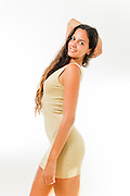 Young woman in her 20s with long brown hair in casual dress. Model release available