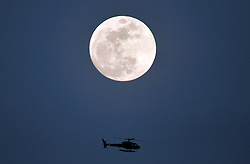 1-30-2018. Van Nuys CA. A helicopter makes a flyby a super blue moon as part of moon events to be in the early morning hours of Wednesday morning. It's when a super moon (full moon close to earth in orbit), blue moon (the second full moon in a month), and lunar eclipse all occur on the same night. Early Wednesday morning (January 31st) is the first super blue blood moon in 150 years. Ready your telescopes. Photo by Gene Blevins/LA DailyNews/SCNG/ZumaPress. (Credit Image: © Gene Blevins via ZUMA Wire)