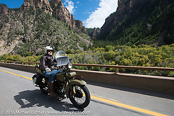 Greg McFarland riding his 1926 Harley-Davidson JD on Interstate 70 in Glenwood Canyon beside the Colorado River during Stage 10 (278 miles) of the Motorcycle Cannonball Cross-Country Endurance Run, which on this day ran from Golden to Grand Junction, CO., USA. Monday, September 15, 2014.  Photography ©2014 Michael Lichter.