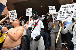 © Licensed to London News Pictures. 19/07/2017. London, UK. Protesters hold a demonstration outside Kensington Chelsea Town Hall during a council meeting to discuss the Grenfell Tower tragedy. Photo credit: Ray Tang/LNP