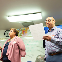 University of New Mexico Training & Development Consultants Ybeth Iglesias, left, and Samuel Rodriguez, right, recite a poem to complete the training for the Weimagination class at the UNM-Gallup campus on Nov. 30th.