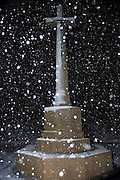 Israel, Jerusalem, Commonwealth World War I cemetery on Mt. Scopus, snow flakes falling on the entral memorial cross. Winter, January 2007