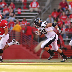 Sep 19, 2009; Piscataway, NJ, USA; Rutgers quarterback Tom Savage (7) scrambles away from Florida International defensive end Thatcher Starling (99) during the first half of NCAA college football between Rutgers and Florida International at Rutgers Stadium.
