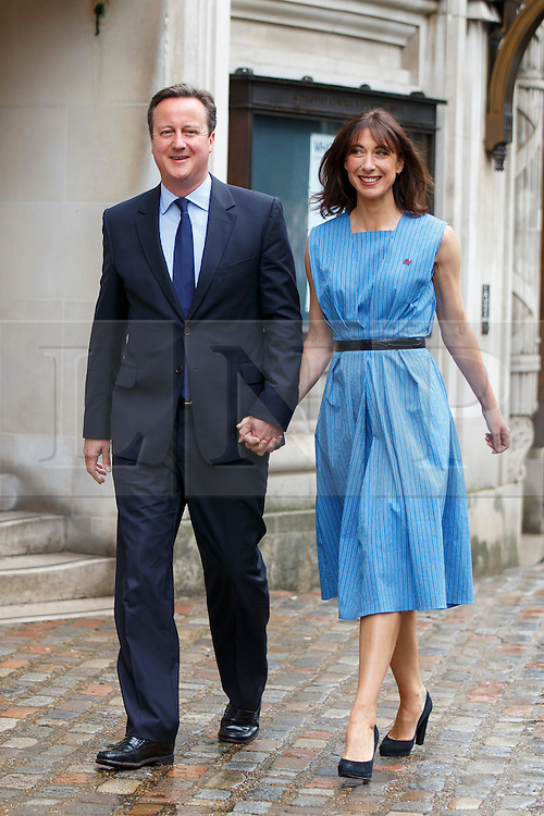 © Licensed to London News Pictures. 23/06/2016. London, UK. British prime minister DAVID CAMERON arrives at Methodist Central Hall in Westminster with his wife SAMANTHA CAMERON, to cast his vote in the EU referendum. Photo credit: Tolga Akmen/LNP