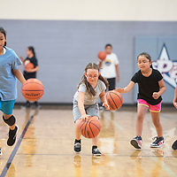 Campers dribble basketballs down the court during a drill Wednesday, July 17 at the Miyamura Lady Patriots Basketball Kiddie Camp in Gallup.