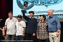 Suicide Customs came all the way from Anjyo City, Japan with their 1000cc Ironhead Rumble Racer that they had to finish assembling in Germany and then get started before it was accepted into the competition. It was worth the effort as here they are on stage accepting the Grand Championship trophy and ring at the AMD World Championship of Custom Bike Building Award Ceremony on the stage in the custom dedicated Hall 10 at the Intermot Motorcycle Trade Fair. Cologne, Germany. Sunday October 9, 2016. Photography ©2016 Michael Lichter.