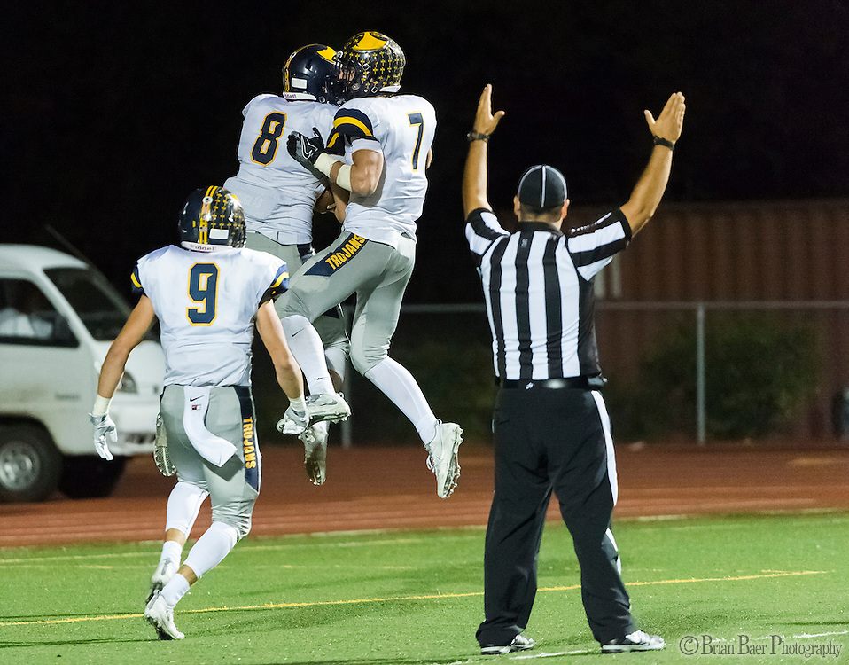 Oak Ridge Trojans Kyle Brown (8), celebrate his touchdown with teammates to lead 33-25 during the fourth quarter as the Del Oro Golden Eagles varsity football team host the Oak Ridge Trojans, Friday Oct 21, 2016.<br /> photo by Brian Baer