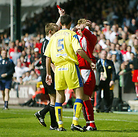 Photo: Chris Ratcliffe.<br />Leyton Orient v Peterborough United. Coca Cola League 2. 29/04/2006.<br />Paul Connor of Orient is sent off by referee Paul Melin for an elbow on  Peterborough captain Phil Carden.