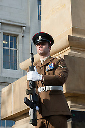 A Member of the Yorkshire Regiment stands on corner guard at the Barnsley War Memorial outside the Town Hall as  Barnsley Marks the Centenary of the out break of World War I on Remembrance Sunday <br /> <br /> 09 November 2014<br /> <br /> Image © Paul David Drabble <br /> <br /> www.pauldaviddrabble.co.uk