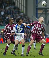 Photo Aidan Ellis.<br />Blackburn Rovers v Manchester City (FA Barclaycard Premiership) 01/03/03<br />Blackburn's Hakan Sukur and City's Gerard Wwiekens and Sylvain Distin