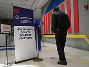 Voters line up for the start of early voting at the Montgomery County Board of Elections.