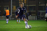 Bolton's Eidur Gudjohnsen warming up prior to kick off. Barclays U21 Premier league match, Bolton Wanderers U21's  v Middlesbrough U21's at The Leyland county ground in Bolton, Lancs on Monday 1st December 2014.<br /> pic by Chris Stading, Andrew Orchard sports photography.