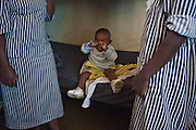 A baby living inside Thika Women's Prison. At present there are 6 young children inside the prison that get looked after in a small cell for the day whilst the mothers go to work. Action for children in conflict (AFCIC) provides day care, clothes and resources for the children to play with.