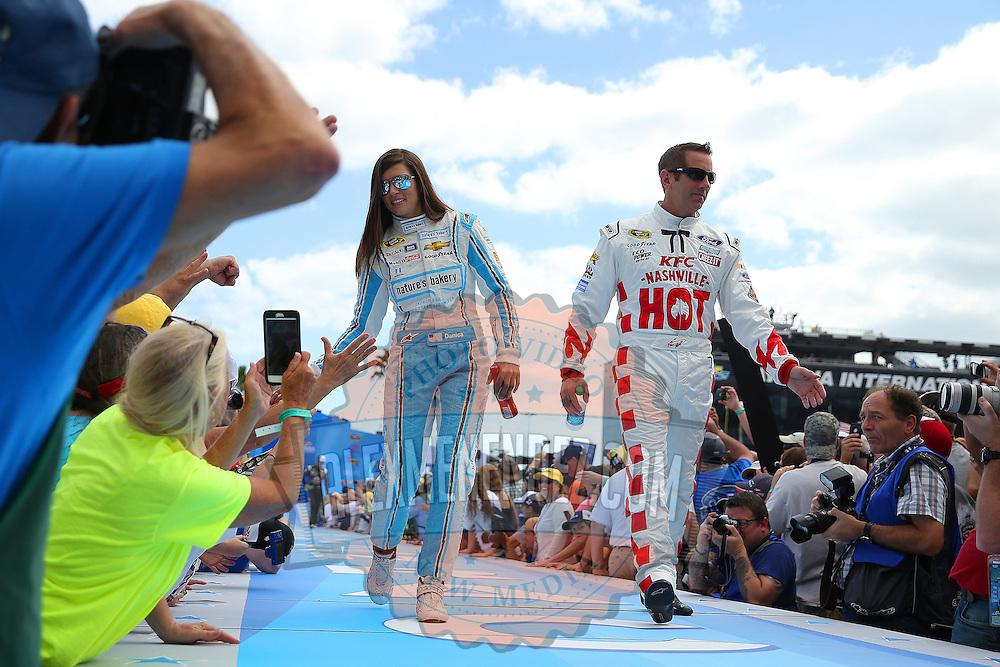 Race car drivers Danica Patrick (L) and Greg Biffle are seen during driver introductions prior to the 58th Annual NASCAR Daytona 500 auto race at Daytona International Speedway on Sunday, February 21, 2016 in Daytona Beach, Florida.  (Alex Menendez via AP)
